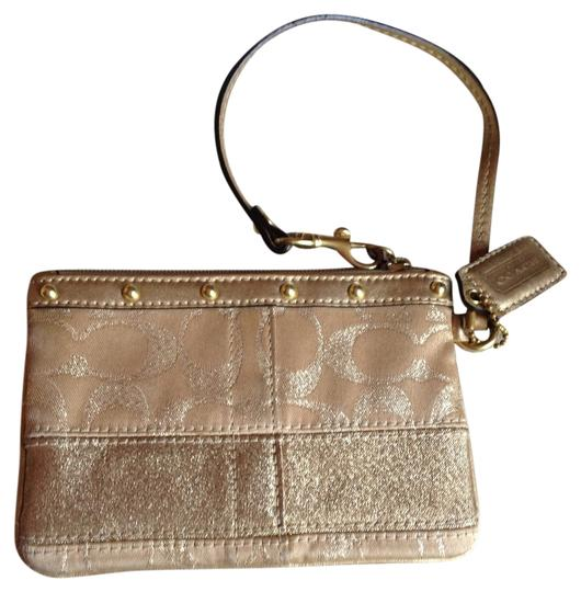 Coach Wristlet in gold and coral