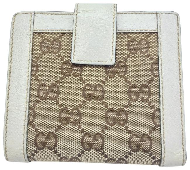 Item - Brown and White Gg Monogram Trifold Wallet