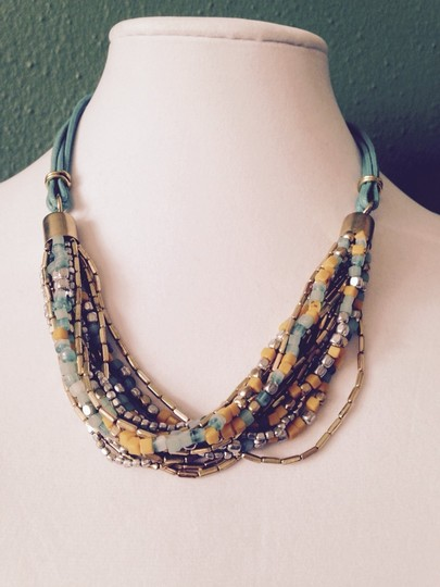 Kenneth Cole Kenneth Cole Yellow, Turquoise, Silver & Gold Long NecklaceOnly! Matching Pieces Sold Seperately.