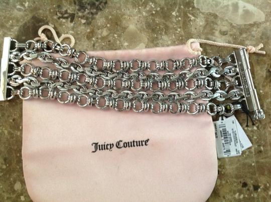 Juicy Couture Rare Juicy Couture Silver chain link bracelet heavy, not cheap. .