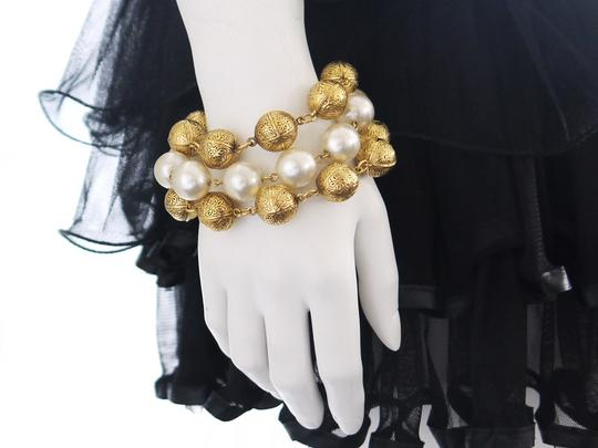 Preload https://item2.tradesy.com/images/chanel-gold-faux-pearl-x-golden-ball-triple-chain-bracelet-295751-0-0.jpg?width=440&height=440