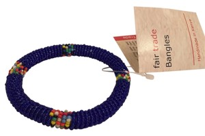 Kenyan beaded bangle bracelet in royal blue with colored accents.