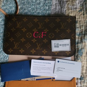 Louis Vuitton Wristlet in Brown with blue inside