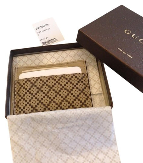 Preload https://item2.tradesy.com/images/gucci-brown-diamante-laser-leather-card-case-2970901-0-0.jpg?width=440&height=440