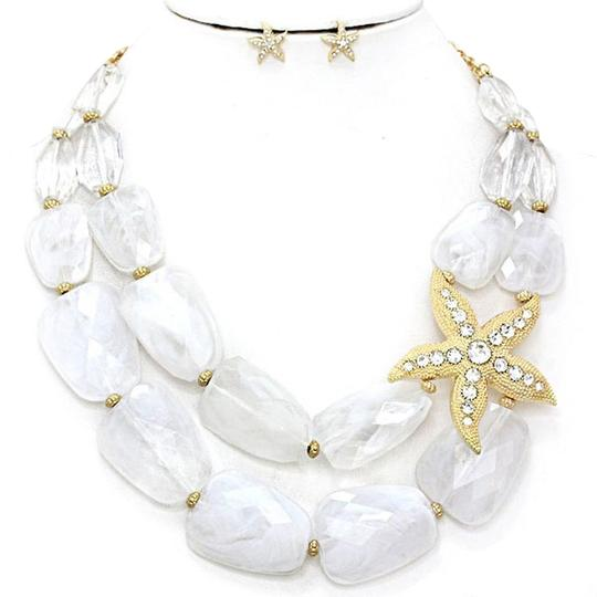 Preload https://img-static.tradesy.com/item/2972764/fashionista-white-and-gold-chunky-beads-starfish-accent-double-strand-necklace-0-4-540-540.jpg