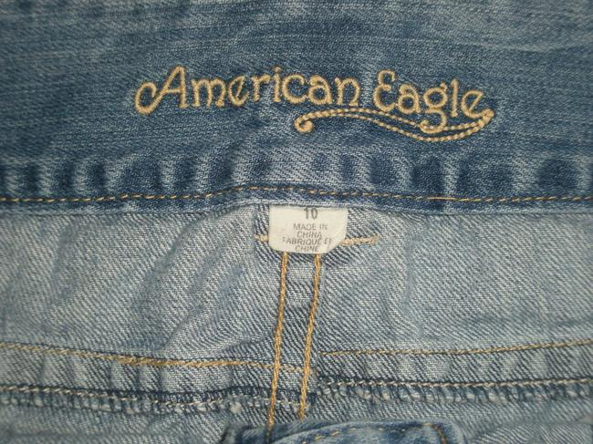 American Eagle Outfitters Frayed Hem * Double Button Waist Closure * Back Flap Pockets With Button Closure * Medium Wash * Cotton * Machine * * Mini Skirt Blue