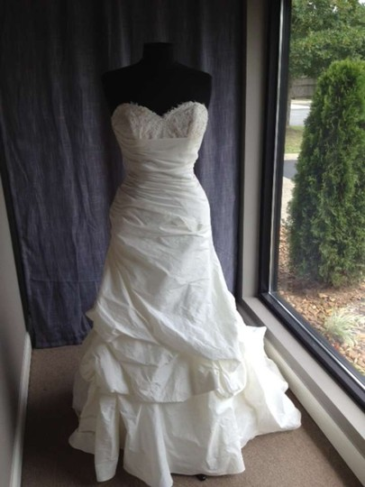 Preload https://item2.tradesy.com/images/ivory-18781-wedding-dress-size-10-m-298216-0-0.jpg?width=440&height=440