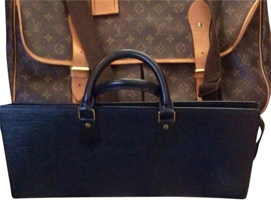 Preload https://item4.tradesy.com/images/louis-vuitton-sac-tricot-triangle-party-black-epi-leather-hobo-bag-2990623-0-0.jpg?width=440&height=440