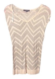 A Pea In The Pod Cream and black dots sleeveless sweater..never worn