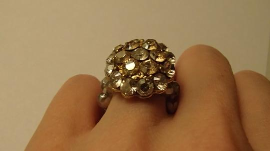 Other Costume Jewelry ring with stretchy band in gold and silver tones