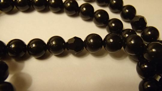 Other Black beaded necklace convertible to bracelet with gold clasp and blue jewel. Costume Jewelry