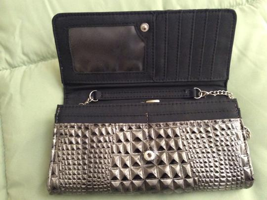 "Other Black/silver clutch wallet with 8"" drop silver chain."