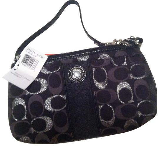 Preload https://item5.tradesy.com/images/coach-black-and-silver-wristlet-30009-0-0.jpg?width=440&height=440