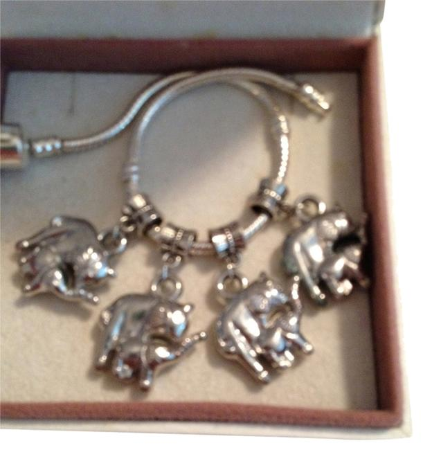 Item - Silver Set Of 4 Dangling Mother Elephant and Baby Elephant Charm