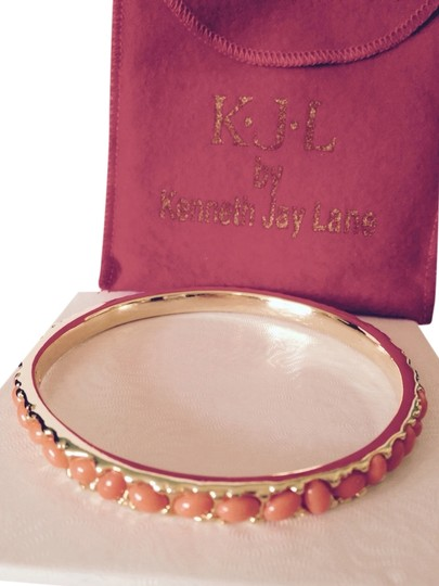 Kenneth Jay Lane Orange Cabochon & Gold Bangle With Red Logo Pouch