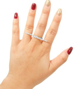 MODERN EDGE'S SILVER TONE AND RHINESTONE BAR RING