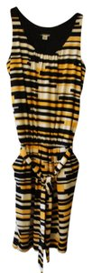 Worthington short dress Black, Gold, and White on Tradesy