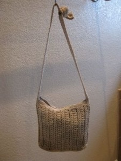 Preload https://item3.tradesy.com/images/crochet-style-light-brown-cotton-and-polyethylene-shoulder-bag-30357-0-0.jpg?width=440&height=440