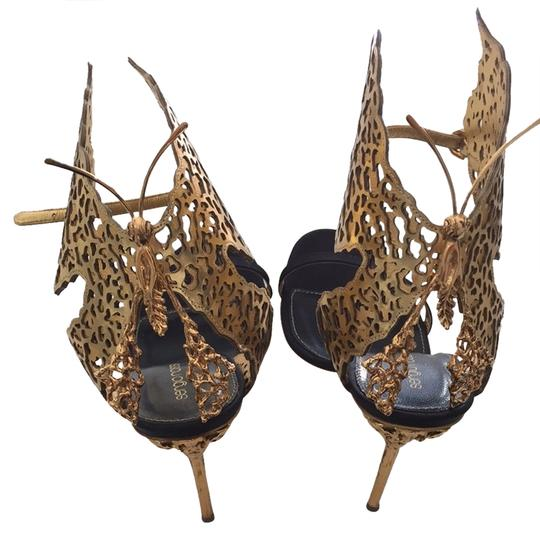 Preload https://item3.tradesy.com/images/gold-and-black-filigree-butterfly-laser-cut-sandals-size-us-11-regular-m-b-3037432-0-0.jpg?width=440&height=440