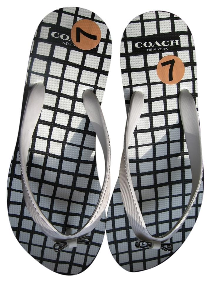6f65ff14b6de Coach White Black Amel and Square Checkered with Silver Metal Bow Flip Flops  In Flats