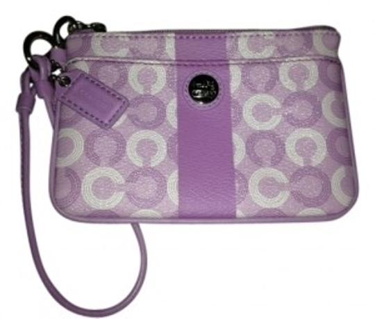 Preload https://item2.tradesy.com/images/coach-small-purple-signature-coated-canvas-with-leather-trim-wristlet-30581-0-0.jpg?width=440&height=440