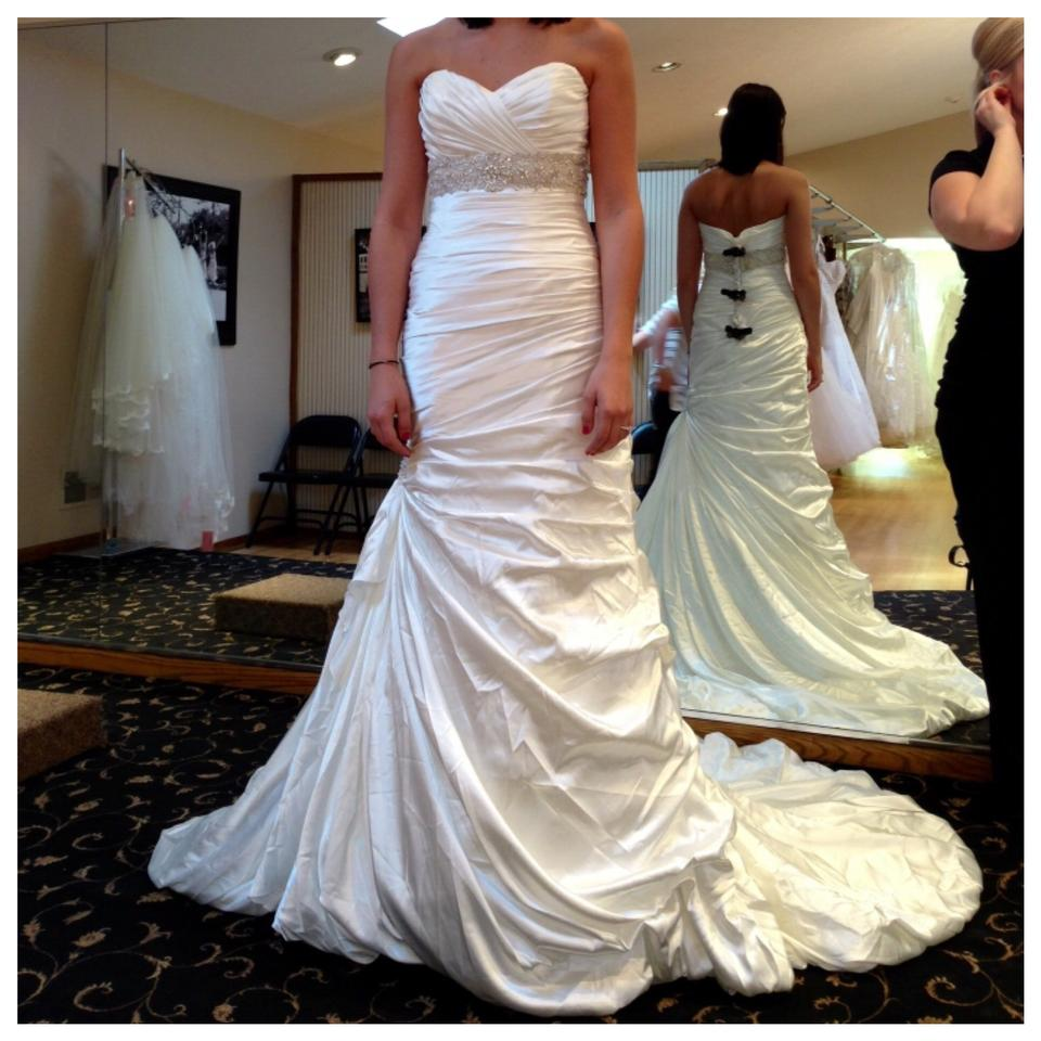 Used wedding dresses buy sell your wedding dress tradesy for Sell preowned wedding dress