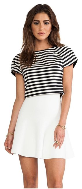 Preload https://item2.tradesy.com/images/alice-olivia-tunic-blackwhite-3084766-0-0.jpg?width=400&height=650