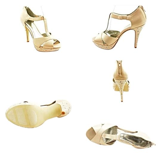 Preload https://item2.tradesy.com/images/style-and-co-beige-the-suki-heels-pumps-size-us-75-regular-m-b-3094381-0-0.jpg?width=440&height=440