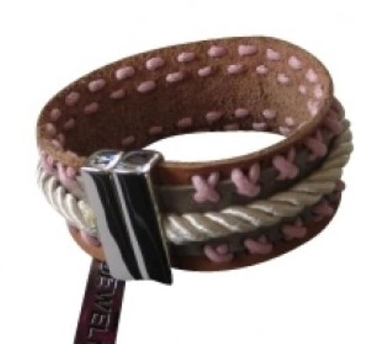 Preload https://item5.tradesy.com/images/jewelmint-pink-and-tan-magnetic-leather-lasso-cuff-bracelet-30994-0-0.jpg?width=440&height=440