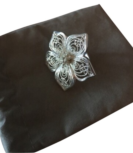 Preload https://item2.tradesy.com/images/mia-silver-large-925-flower-ring-size-7-3099811-0-0.jpg?width=440&height=440
