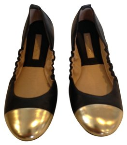 Michael Kors BLACK AND GOLD Flats