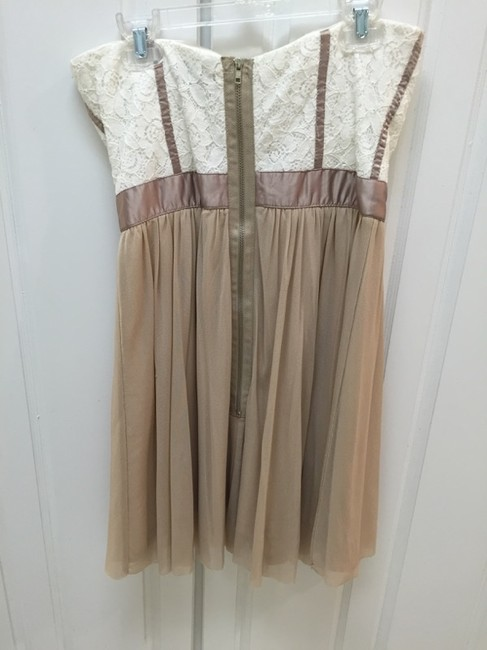 Justify short dress Tan Strapless Floral on Tradesy
