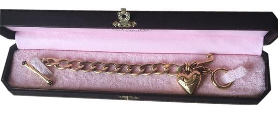 Preload https://item4.tradesy.com/images/juicy-couture-juicy-couture-gold-tone-charm-bracelet-3183373-0-0.jpg?width=440&height=440