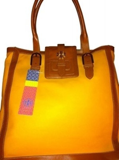 Preload https://item1.tradesy.com/images/tory-burch-style-22129840-dash-ns-golden-yellow-coated-canvas-and-leather-tote-31855-0-0.jpg?width=440&height=440
