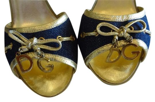 Preload https://item3.tradesy.com/images/dolce-and-gabbana-denin-blue-and-gold-mules-3228952-0-0.jpg?width=440&height=440