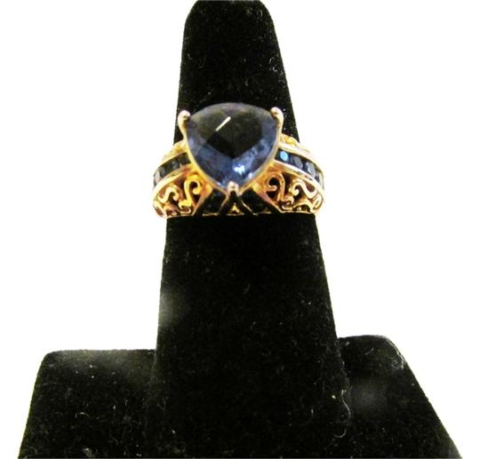 Preload https://item2.tradesy.com/images/technibond-925-simulated-tanzanite-size-8-ring-3230746-0-0.jpg?width=440&height=440