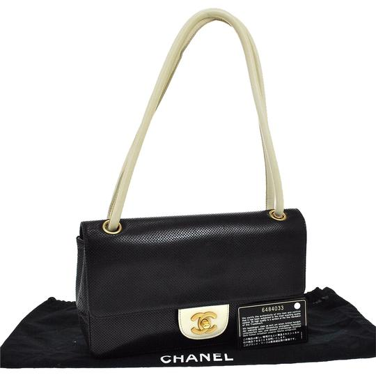 Preload https://item4.tradesy.com/images/chanel-classic-flap-perforated-black-lambskin-leather-shoulder-bag-3240778-0-3.jpg?width=440&height=440