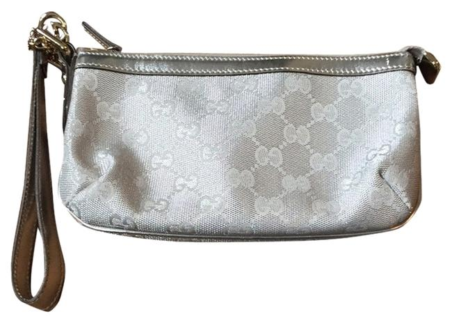 Item - Monogram Silver Canvas and Leather Exterior. Canvas Interior Wristlet