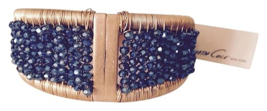 Preload https://item5.tradesy.com/images/kenneth-cole-bluegold-gold-tone-bead-hinged-bracelet-only-matching-pieces-seperately-3249859-0-0.jpg?width=440&height=440