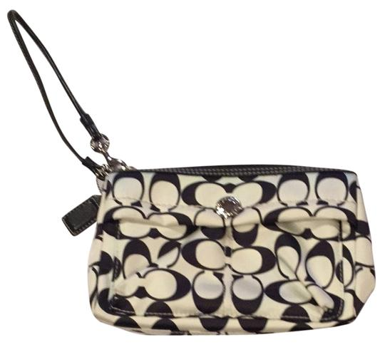 Preload https://item3.tradesy.com/images/coach-signature-logo-black-and-white-wipeable-material-wristlet-3282937-0-0.jpg?width=440&height=440