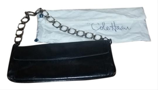 Preload https://item1.tradesy.com/images/cole-haan-black-silver-hardware-leather-clutch-3290500-0-0.jpg?width=440&height=440