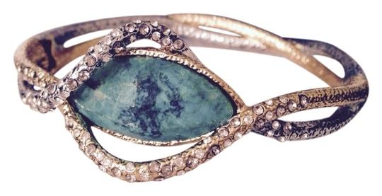 Preload https://item1.tradesy.com/images/alexis-bittar-turquoisegunmetalgold-faceted-chrysocolla-and-crystal-encrusted-hinge-bracelet-3292660-0-0.jpg?width=440&height=440