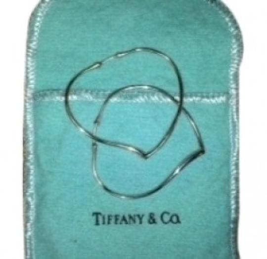Preload https://img-static.tradesy.com/item/33093/tiffany-and-co-sterling-silver-elsa-perreti-heart-hoops-vintage-large-no-l-earrings-0-0-540-540.jpg