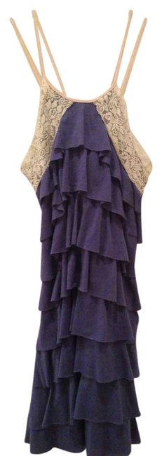 Alythea short dress Blue Ruffle Lace Trim Crisscross Strap Mini on Tradesy