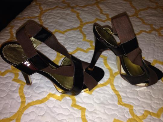 bebe Brown and gold Pumps