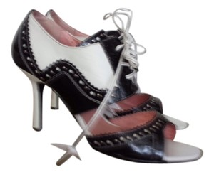 N.Y.L.A. Black and white spectator Pumps