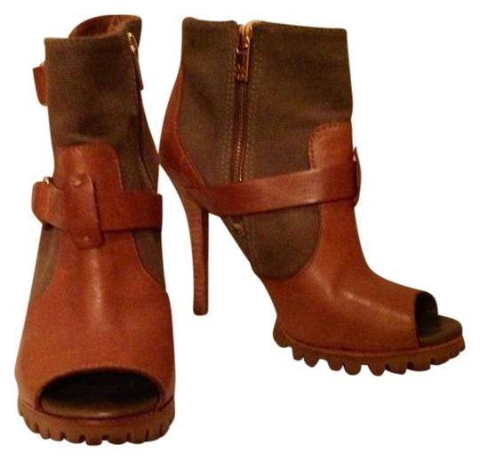 Preload https://item1.tradesy.com/images/tory-burch-green-brown-bootsbooties-size-us-75-336300-0-0.jpg?width=440&height=440