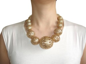 Carved out gold statement necklace