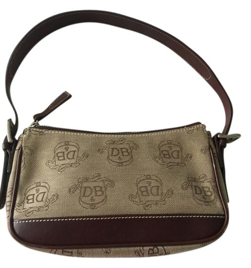 Preload https://item1.tradesy.com/images/dooney-and-bourke-chocolate-brown-leather-and-cream-fabric-with-print-d-and-b-cloth-shoulder-bag-3376525-0-0.jpg?width=440&height=440