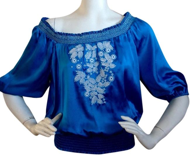 Preload https://img-static.tradesy.com/item/3384694/bebe-blue-silk-embroidered-night-out-top-size-8-m-0-0-650-650.jpg